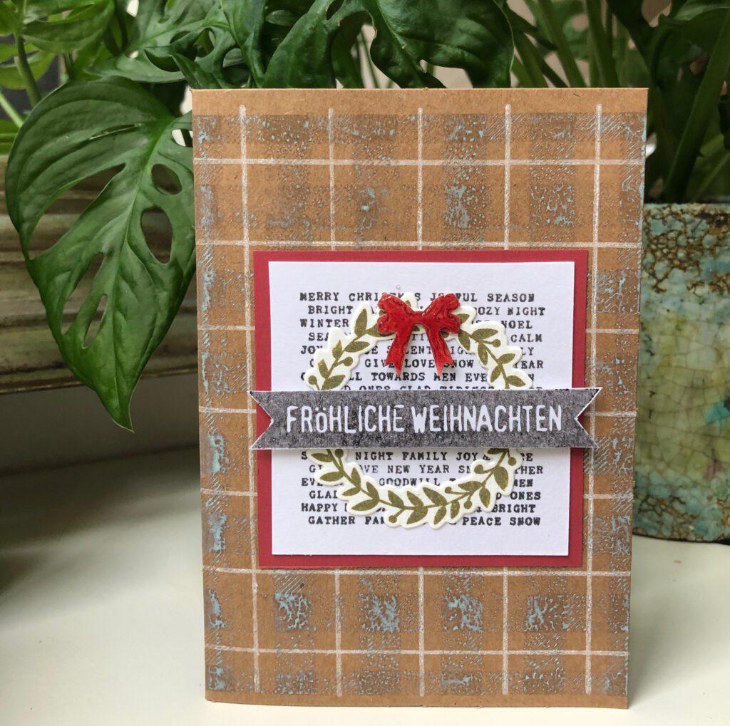 Weihnachtskarte mit ausgestanztem Kranz