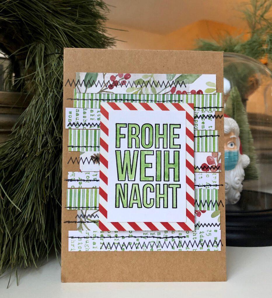 Weihnachtskarte mit Papierresten und Stempeln